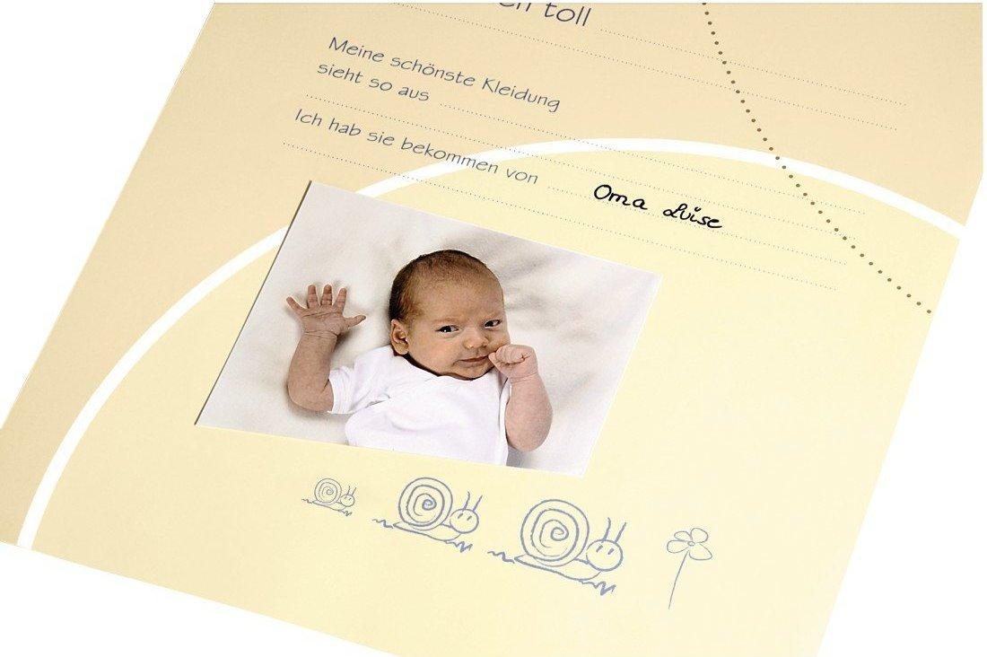 Babyalbum aufgeschlagen Lieblingskleidung