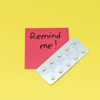 Remind me Zettel mit Pille daneben