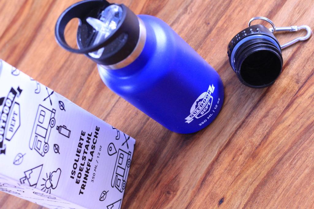 Trinkflasche mit Verpackung und Zubehör