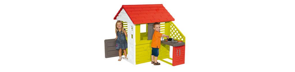 Spielehaus mit spielenden Kindern