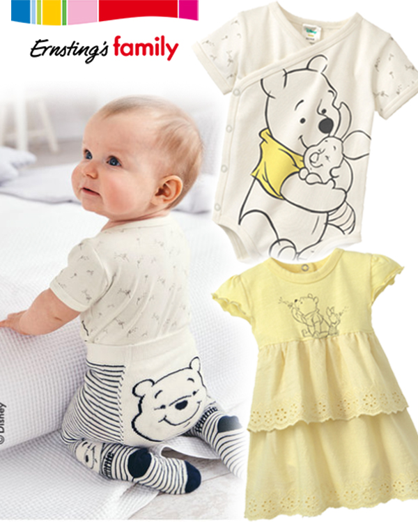 Baby mit Winnie Pooh Outfit