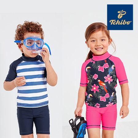 Mädchen und Junge in UV Schutzkleidung