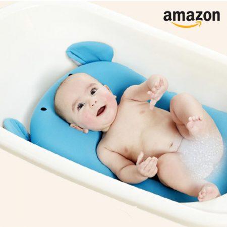 Baby auf Badekissen