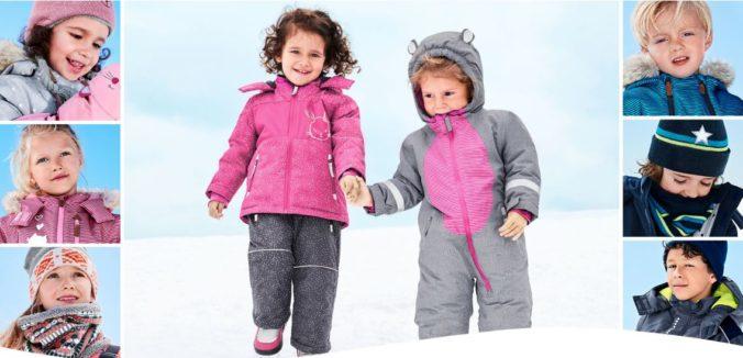 Kinder in Schneeoveralls