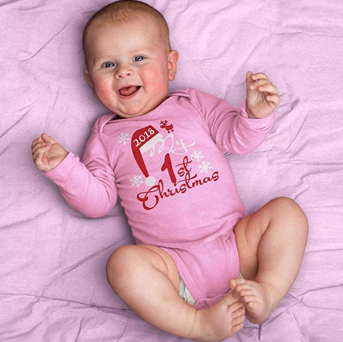 Baby mit rosa Body
