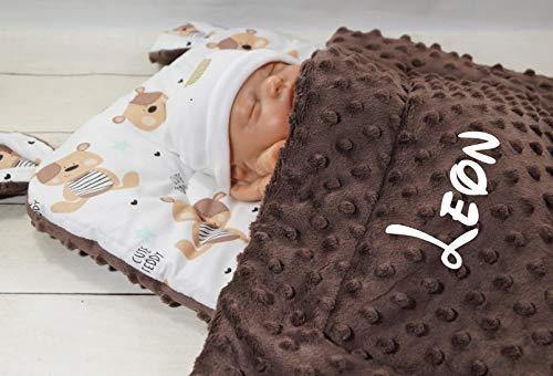 Babypuppe unter Decke