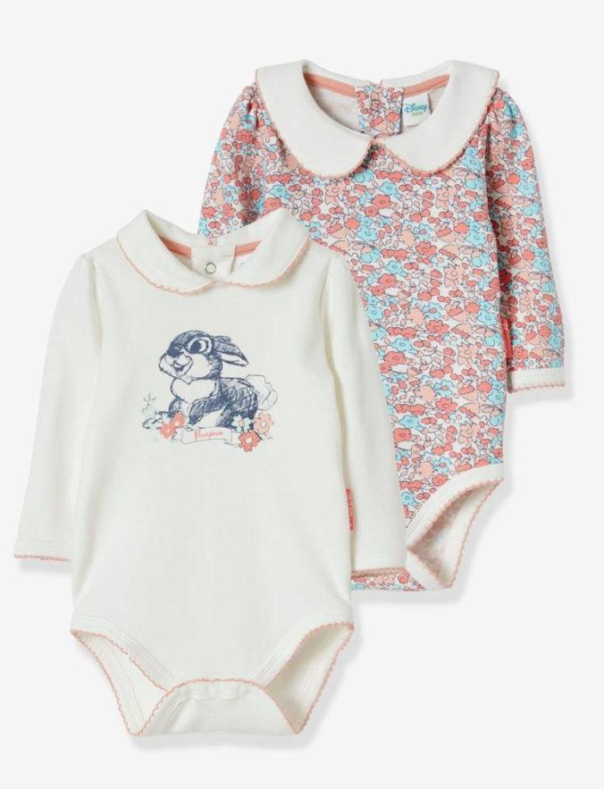 Babybodys mit Klopfer- und Blumenmotiv