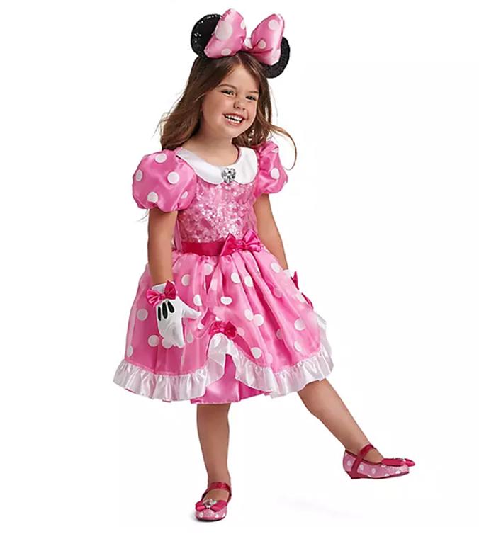 Kind in Minnie Mouse Kostüm