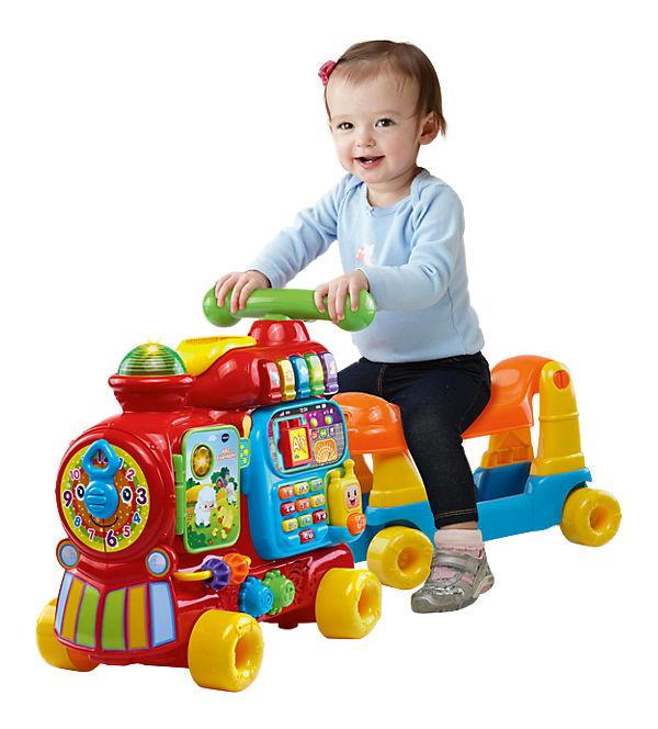 Kind sitzt auf ABC Eisenbahn von Vtech